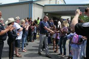 """Texans Embracing America's Military shows Katy-area military recruits of the support they have from their community. The event include """"a celebratory line"""" where recruits are cheered and encouraged."""