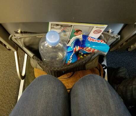 Just barely enough room for a water bottle on Frontier Airlines, which locks up its seats Photo: Kim Grimes