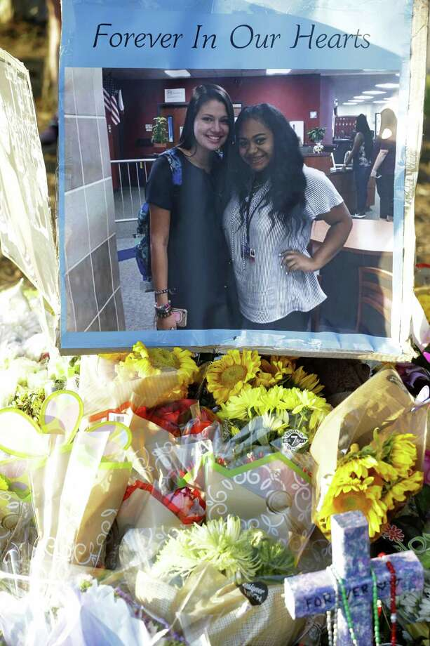 A photo poster of Salma Gomez and Chloe Robison is shown among flowers and other items at the memorial at the scene where the two 16-year-old girls died after a car crash Wednesday, July 25, 2018, in Atascocita. The driver, Jaggar Clayton Smith, 17, has been charged with two counts intoxication manslaughter in connection with a crash that killed passengers Salma Gomez and Chloe Robison, both 16, in the 18300 block of Timber Forest around midnight, the Harris County Sheriff's Office said. Photo: Melissa Phillip, Staff Photographer / Houston Chronicle / © 2018 Houston Chronicle