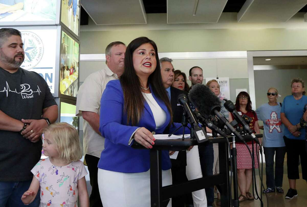 Houston ISD Trustee Elizabeth Santos speaks about teacher pay raises during a press conference at Hattie Mae White Educational Support Center, Thursday, Aug. 2, 2018, in Houston.