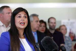 Houston ISD Trustee Elizabeth Santos speaks about the need for teacher pay raises during a press conference at Hattie Mae White Educational Support Center, Thursday, Aug. 2, 2018, in Houston.