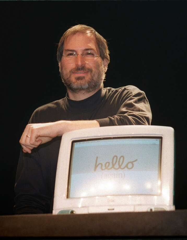"""In this file photo taken on September 17, 1998, Steve Jobs, CEO of Apple, gives a press conference, part of the annual fair """"Apple Expo"""", at the Porte de Versailles in Paris, where he came to promote the latest creation of the American computer Group, the personal computer iMac. Apple -- the culture-changing company behind the iPod, iPhone and iPad -- hit another milestone on Thursday, August 2, 2018, becoming the first private-sector company to surpass $1 trillion in market value. Shares of Apple hit $207.91 in afternoon trading on Wall Street, allowing it to hit the magic number two days after the California tech giant reported strong quarterly earnings. The landmark is the latest victory for Tim Cook, who faced skepticism when he took over as chief executive in 2011 from ailing iconic co-founder Steve Jobs. Photo: ERIC CABANIS /AFP /Getty Images / AFP or licensors"""