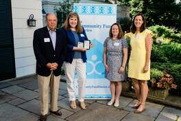 The Community Fund outgoing board President Steve Ward, left, and grants director Lisa Haas, right, present a grant to the Center for Sexual Assault Crisis Counseling and Education, represented by Executive Director Mary Flynn and Development Manager Melissa Gallaher-Smith.