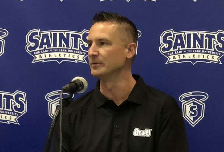 New OLLU men's basketball coach Chris Dial (left) speaks to campus faculty and the media at his introductory press conference at the University Wellness and Activities Center on the OLLU campus on Wednesday afternoon.