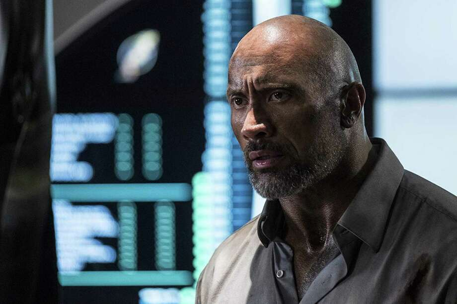"Dwayne Johnson in ""Skyscraper."" Photo: Kimberly French /Universal Pictur / TNS / Los Angeles Times"