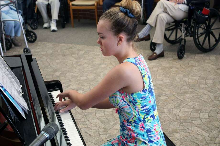 Catherine Burges plays piano during Waveny LifeCare Network's recent Summer Showcase. Photo: Contributed Photo