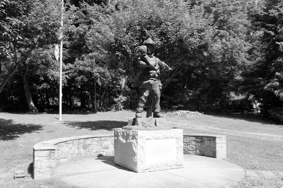 A statue dedicated to the volunteer firefighters of Darien on Post Road. Taken July 16 Photo: Contributed Photo
