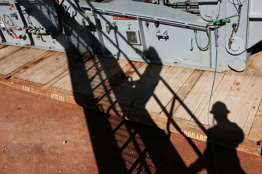 MENTONE, TX - FEBRUARY 05:  The shadows of  workers with Apache Corp. are viewed at the Patterson 298 natural gas fueled drilling rig on land in the Permian Basin on February 5, 2015 in Mentone, Texas. Photo: Spencer Platt/Getty Images