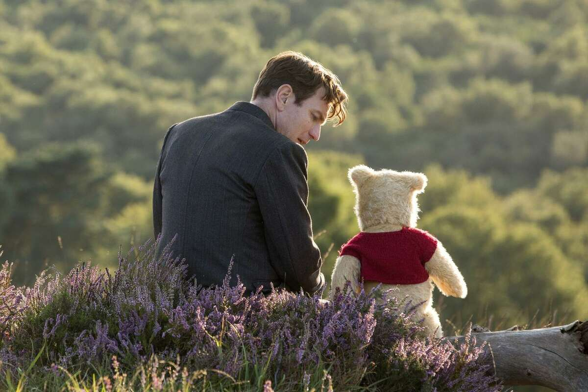 Ewan McGregor is the stressed-out adult Christopher Robin in a return to the Pooh world.
