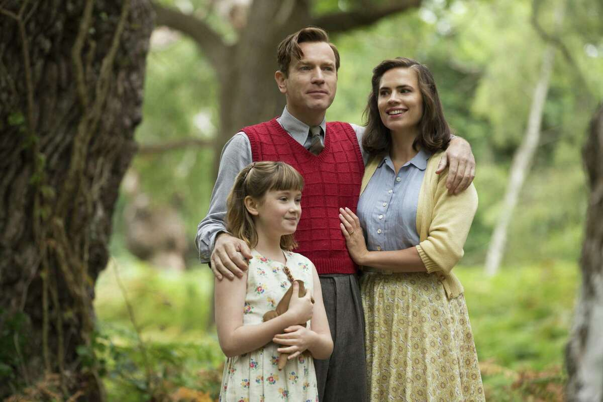 """Bronte Carmichael (left), Ewan McGregor and Hayley Atwell in """"Christopher Robin."""""""