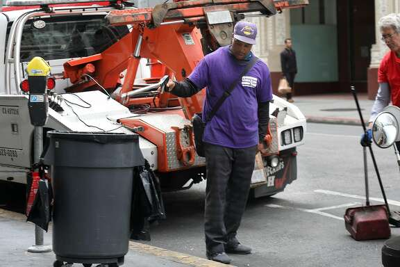 Downtown Street Team supervisor out with his teams near Union Square on Friday, July 27, 2018 in San Francisco, Calif.