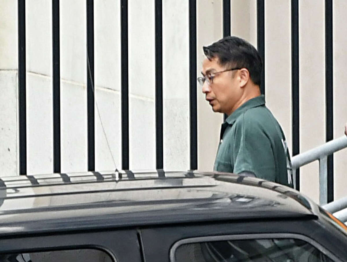 Xiaoqing Zheng, the GE engineer accused of stealing turbine technology from the company, is seen leaving in custody after a detention hearing in federal court on Thursday, Aug. 2, 2018 in Albany, N.Y. (Lori Van Buren/Times Union)