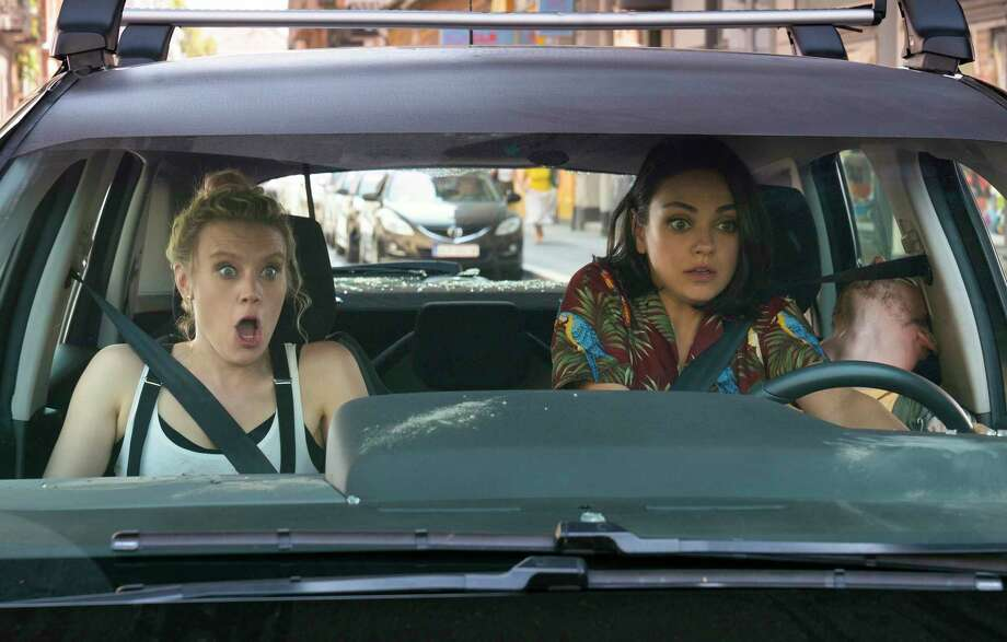 "This image released by Lionsgate shows Kate McKinnon, left, and Mila Kunis in a scene from ""The Spy Who Dumped Me.""  (Hopper Stone/Lionsgate via AP) Photo: Hopper Stone / Lionsgate Entertainment"