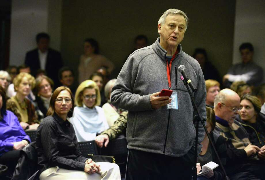 FILE PHOTO — Bob Lion, a member of the Stamford Board of Representatives, speaks during a public hearing, the fourth in a series of seven, by Connecticut Department of Transportation on Tuesday, Feb. 27, 2018 at UConn/Stamford's GenRe Auditorium in Stamford, Connecticut. The purpose of the meeting was to gather input on proposed bus and rail fare increases and service reductions to the New Canaan, Danbury and Waterbury branch lines on the New Haven Line, and on Shore Line East. Photo: Hearst Connecticut Media / Stamford Advocate