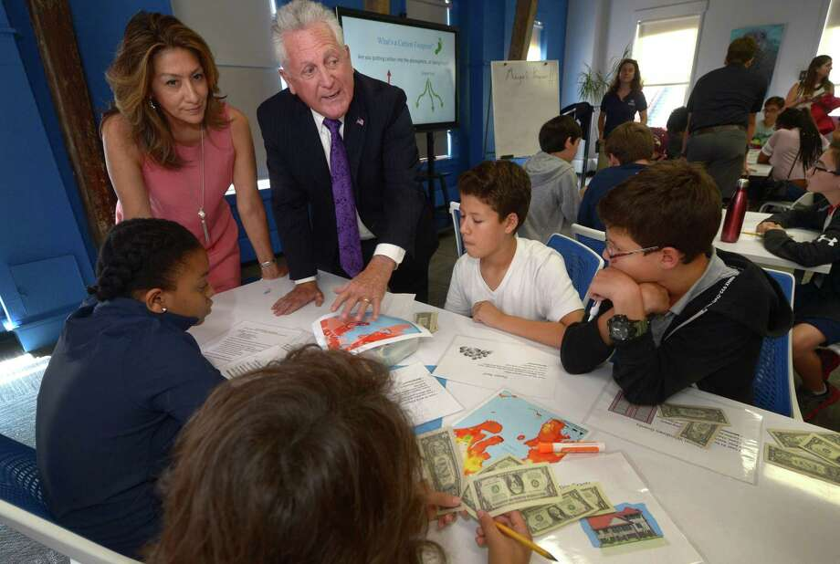 Norwalk Mayor Harry Rilling and his wife Lucia Rilling talk to students, Christine Sainsmyr, 13, Eddie Vera, David Vera and Matthew Vera, all 13,   during The Mayor's Student Engineering & Science Program, a partnership between the city and the Maritime Aquarium, Wednesday, August 1, 2018, at the Aquarium in Norwalk, Conn. Campers broke into small groups representing a fictional coastal community trying to decide how their community better prepares for coastal storms and decide what sort of expenditures will help their community brace for hurricanes and floods. Photo: Erik Trautmann / Hearst Connecticut Media / Norwalk Hour