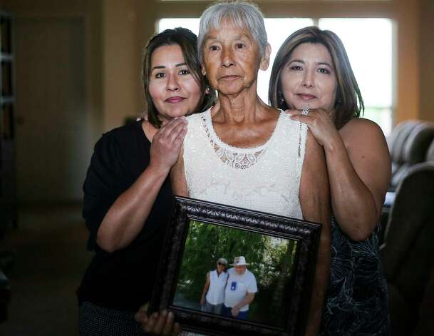 Noemi Barnard holds a photo of her late husband, Ernest Barnard, with her daughters, Graciella Gonzalez, left and Gloria Bivens on Thursday, July 12, 2018, in Katy. He passed away after complications from a heart bypass surgery at St. Luke's Hospital in Houston. Photo: Elizabeth Conley / © 2018 Houston Chronicle