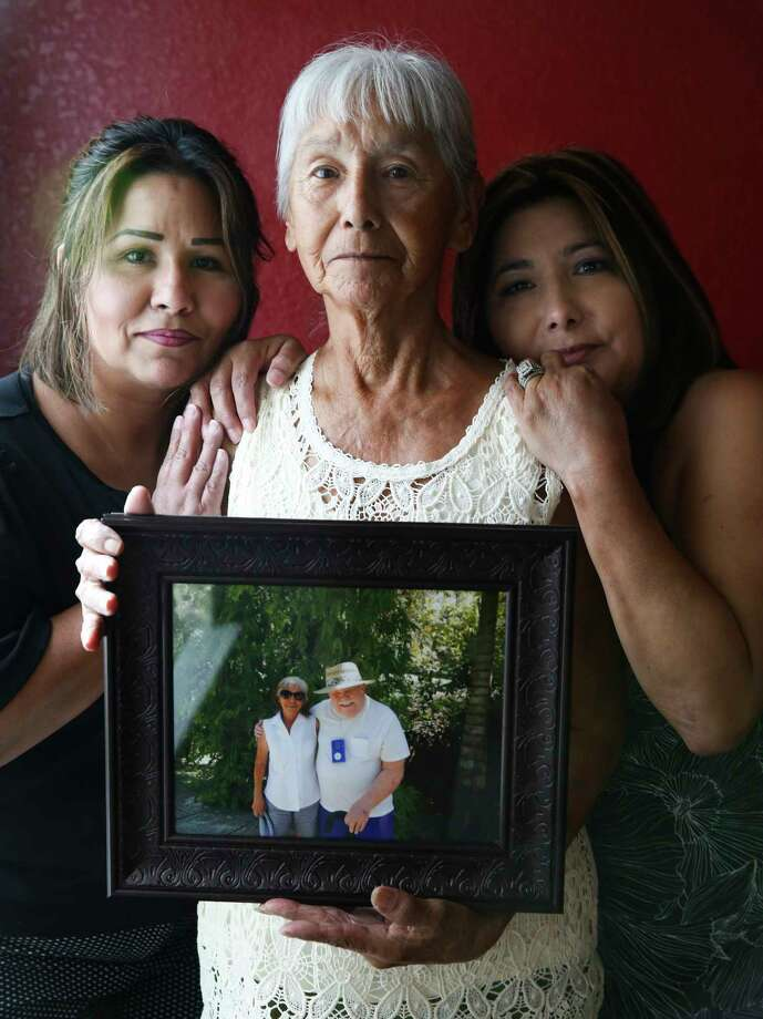 Noemi Barnard holds a photo of her late husband, Ernest Barnard, with her daughters, Graciella Gonzalez, left and GloriaBivenson Thursday, July 12, 2018 in Katy. He passed away after complications from a heart bypass surgery at St. Luke's Hospital in Houston. Photo: Elizabeth Conley, Houston Chronicle / © 2018 Houston Chronicle