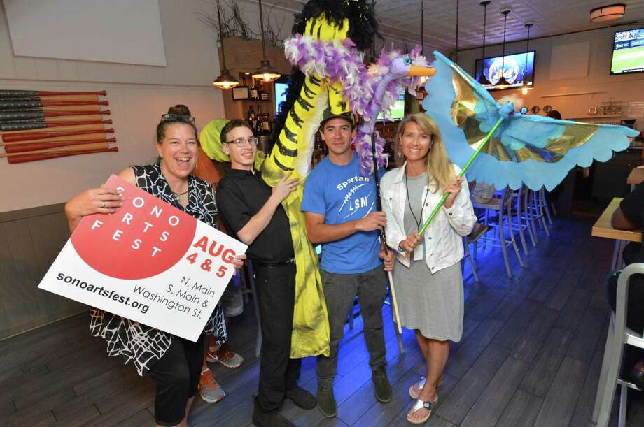 SoNo Arts Festival organizer Sue Brown Gordon holds a sign for this weekend's event along with some of the new puppets held by Andre Denunzio, Mike Boucher and Lorraine Gordon at Dry Dock Bar and Grill on Wednesday August 1, 2018 in Norwalk Conn Photo: Alex Von Kleydorff / Hearst Connecticut Media / Norwalk Hour