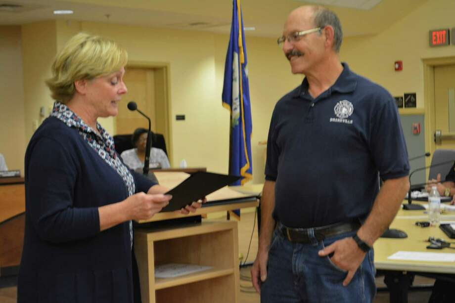 Drakeville Volunteer Fire Department Chief Mike Maccalous was recognized Tuesday at city hall byMayor Elinor Carbone for his 50 years of service. Photo: Leslie Hutchison / Hearst Connecticut Media