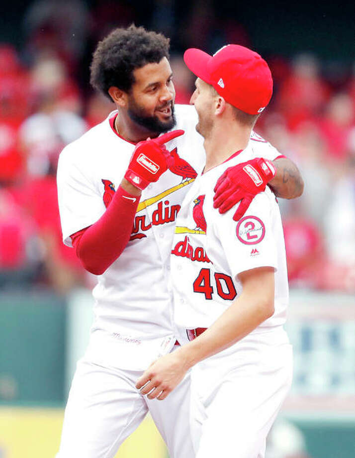 The Cardinals' Jose Martinez, left, celebrates with teammate Chasen Shreve after hitting an RBI walkoff single to defeat the Colorado Rockies 3-2 Thursday at Busch Stadium.