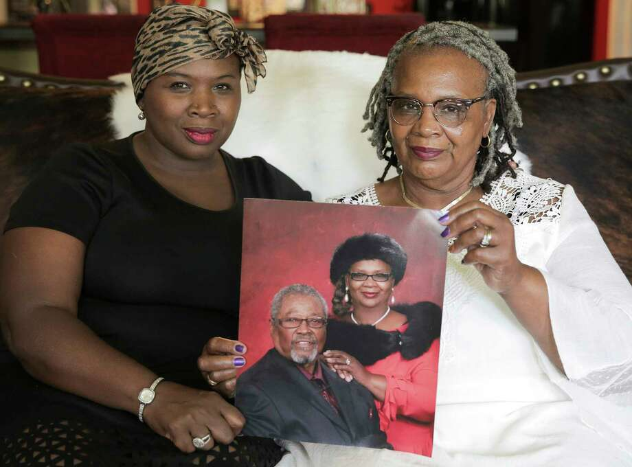 Lisa Blackmon-Jones holds a photo with her mom, Georgia Blackmon, of Blackmon and her late husband, Purnell, in Blackmon's home on Friday, July 20, 2018, in Houston. Photo: Elizabeth Conley / © 2018 Houston Chronicle