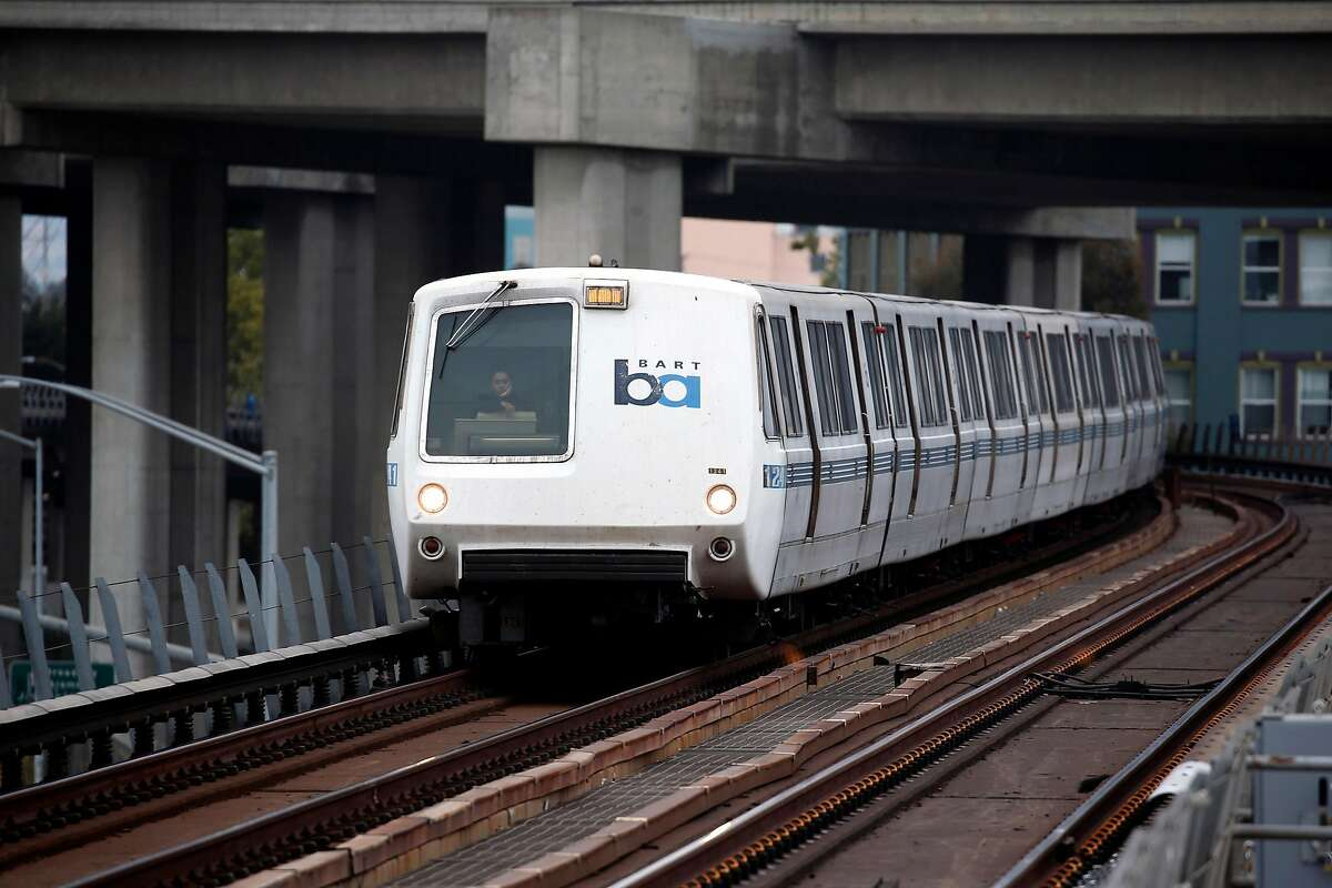 A westbound BART train approaches the West Oakland station in Oakland, Calif. on Thursday, Aug. 2, 2018. BART is setting up a bus bridge between the West Oakland station and the 19th Street and Lake Merritt stations during selected weekends in August and September to perform critical track work.