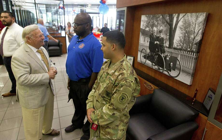 U.S. Army veteran Sgt. Robert Bonner, Jr. shares a laugh next to Tony Gullo, Sr., left, and Army recruiting Sgt. Edwardo Aponte before Bonner was presented with a new car as part of the Military Warriors Support Foundation at Gullo Ford on Thursday, Aug. 2, 2018, in Conroe. Military Warriors is a nonprofit, which aims to help transition military members and their family into civilian life. Photo: Jason Fochtman, Staff Photographer / Houston Chronicle / © 2018 Houston Chronicle
