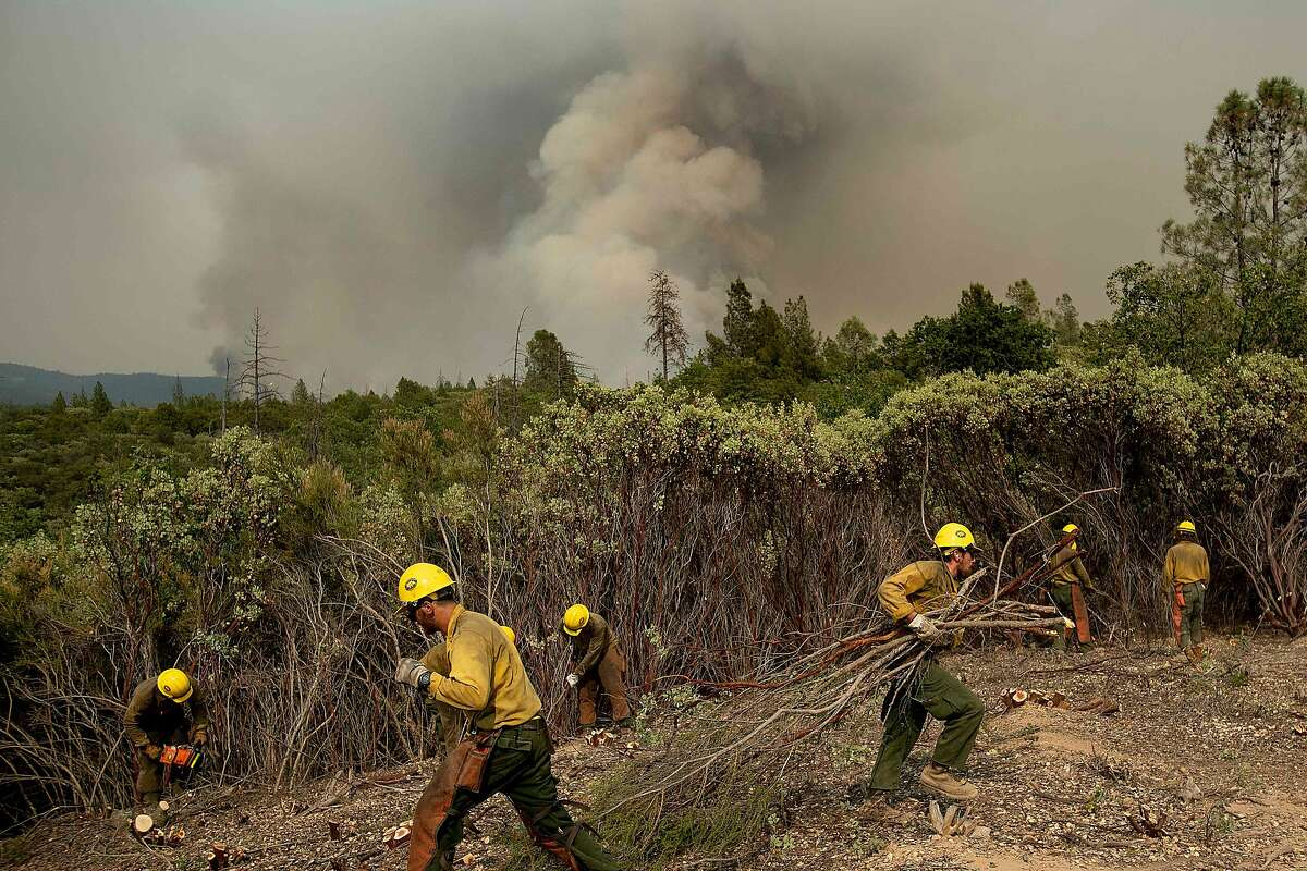 Firefighters from the Big Bear Hotshots create a firebreak as the Ferguson fire approaches in the Stanislaus National Forest, near Yosemite National Park, California, on July 21, 2018. A fire that claimed the life of one firefighter and injured two others near California's Yosemite national park has almost doubled in size in three days, authorities said Friday. The US Department of Agriculture (USDA) said the so-called Ferguson fire had spread to an area of 22,892 acres (92.6 square kilometers), and is so far only 7 percent contained. / AFP PHOTO / NOAH BERGERNOAH BERGER/AFP/Getty Images