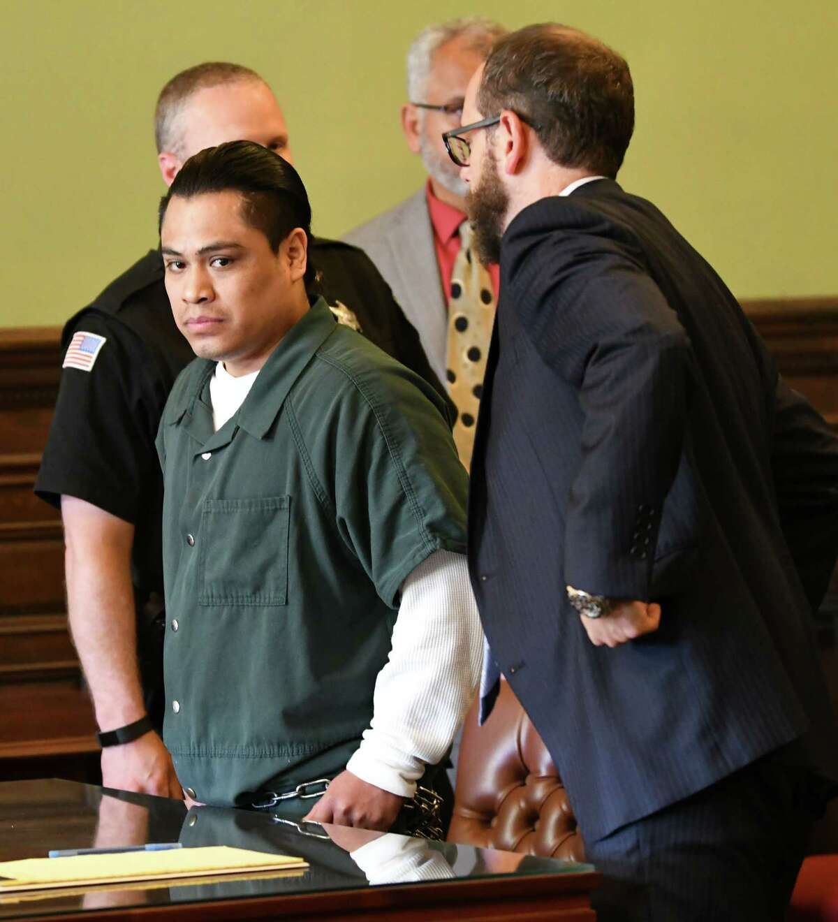 Cresencio Salazar is seen in the courtroom as his attorney Trevor Hannigan, right, talks to a police officer at the Rensselaer County Court House on Thursday, Aug. 2, 2018 in Troy, N.Y. Salazar was not indicted by DA Joel Abelove within 45 days as set by state law in the case of two Mexican nationals allegedly killed by Salazar and three other men, all of whom are Mexican nationals.(Lori Van Buren/Times Union)