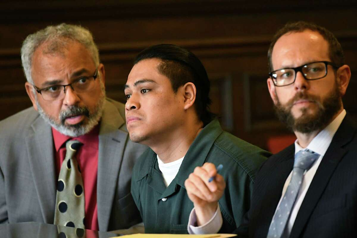 Interpreter Jorge Baldizon, left, translates for Cresencio Salazar, center, as his attorney Trevor Hannigan, right, listens to Cheryl McDermott, assistant district attorney, speak to State Supreme Court Justice Andrew Ceresia at the Rensselaer County Court House on Thursday, Aug. 2, 2018 in Troy, N.Y. Salazar was not indicted by DA Joel Abelove within 45 days as set by state law in the case of two Mexican nationals allegedly killed by Salazar and three other men, all of whom are Mexican nationals.(Lori Van Buren/Times Union)