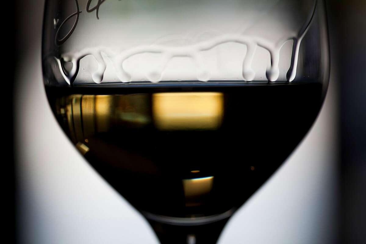 A glass of 2009 �Bella Sandra� Chardonnay inside the Silvestri tasting room in Carmel Village, Calif., Friday, September 7, 2012.