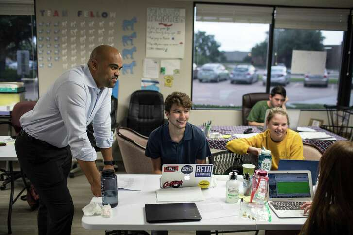 Colin Allred, left, a Democratic candidate for the House, speaks with volunteers at his campaign headquarters in Richardson, Texas, on June 7, 2018. Allred, a former professional football players, is getting financial help from a new political action committee created by the NFL Players Association. (Tamir Kalifa/The New York Times)