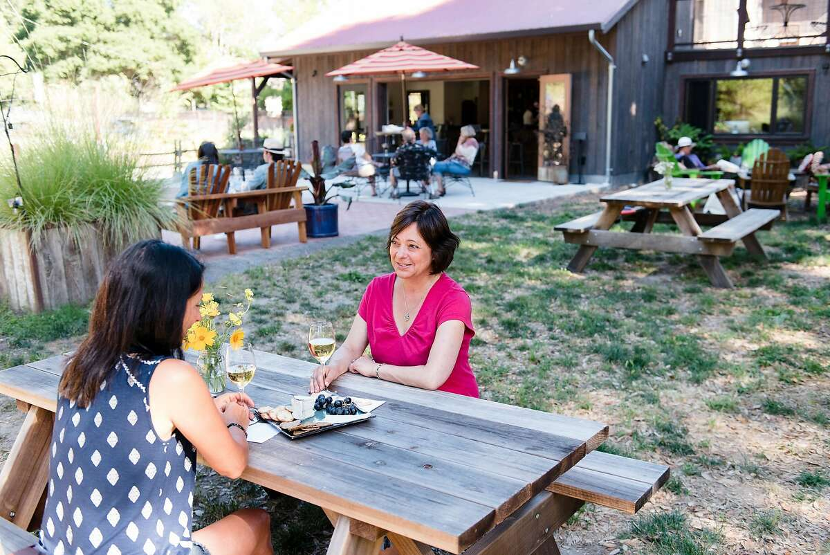 Lori LaForge and Julie Bohny sip chardonnay with a cheese plate at Horse & Plow Winery in Sebastopol, Calif., on Friday June 1, 2018.