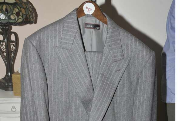 This photo provided by the Department of Justice was introduced into evidence by the government on Wednesday, Aug. 1, 2018, during the second day of the fraud trial of former Trump campaign chairman Paul Manafort in federal court in Alexandria, Va., shows clothing owned by Manafort. Manafort is accused of conspiracy to evade U.S. taxes and banking laws. It's the first trial arising from special counsel Robert Mueller's Russia probe.(Department of Justice via AP)