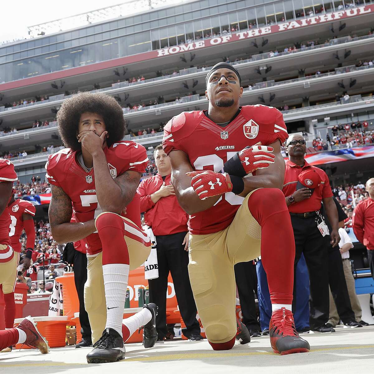 September 1 2016 - Kaepernick (L) is joined by Eric Reid (R) in kneeling for the national anthem. They opted to kneel rather than sit down (as Kaepernick had been doing) to show more respect for military. This picture was taken a month later, on Oct. 2, 2016 before an NFL football game against the Dallas Cowboys in Santa Clara, Calif.
