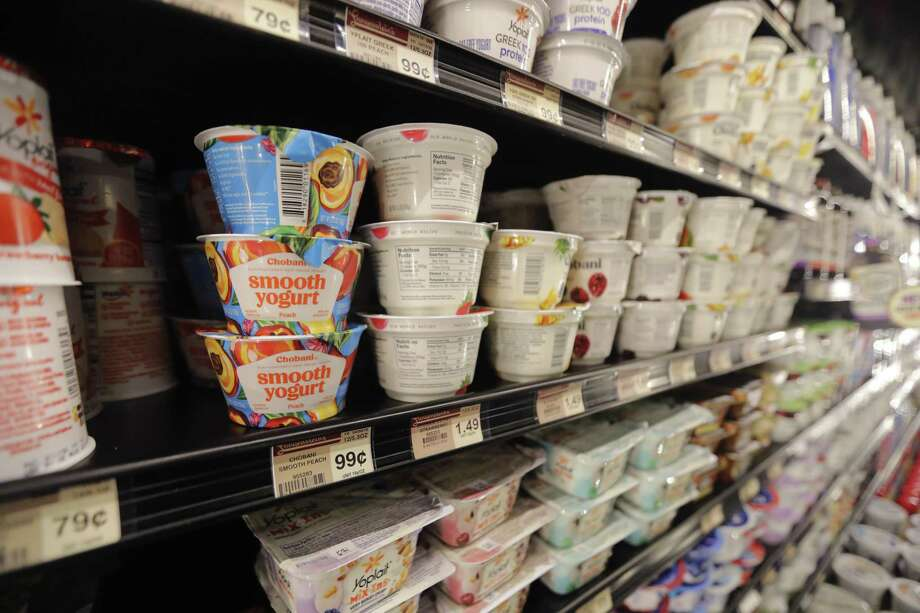 Yogurt is seen on display at a grocery store Photo: Gerald Herbert / Associated Press / Copyright 2018 The Associated Press. All rights reserved.