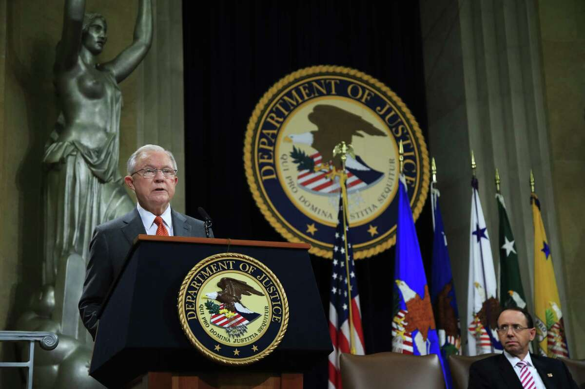 Attorney General Jeff Sessions speaks during a Religious Liberty Summit at the Department of Justice, Monday, July 30, 2018. Seated on the right is Deputy Attorney General Rod Rosenstein.