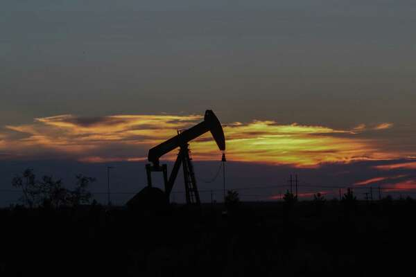 An oil rig at sunset in Midland, Texas Tuesday, June 27, 2017, in Midland. ( Steve Gonzales / Houston Chronicle )