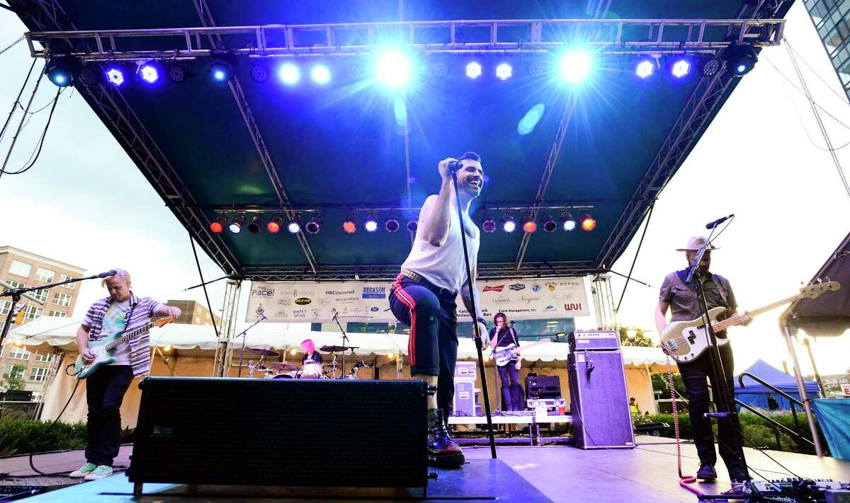 Tyler Glenn, lead vocals for the rock band Neon Trees, center, performs at the Alive@Five summer concert series at Columbus Park in Stamford, Connecticut on August 2, 2018.