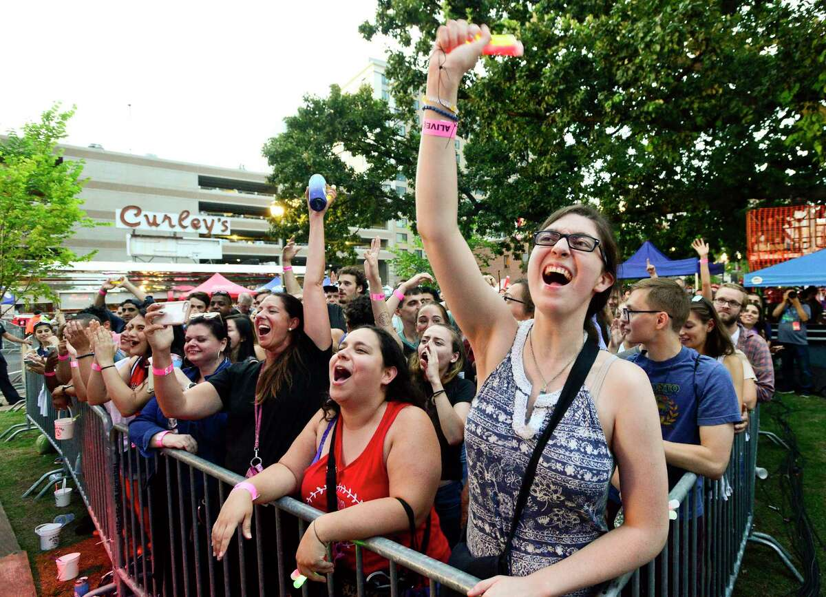 Liz Friell of Westport, at right, gets into the performance of the rock band Neon Trees, as they close out the Alive@Five summer concert series at Columbus Park in Stamford, Connecticut on August 2, 2018.