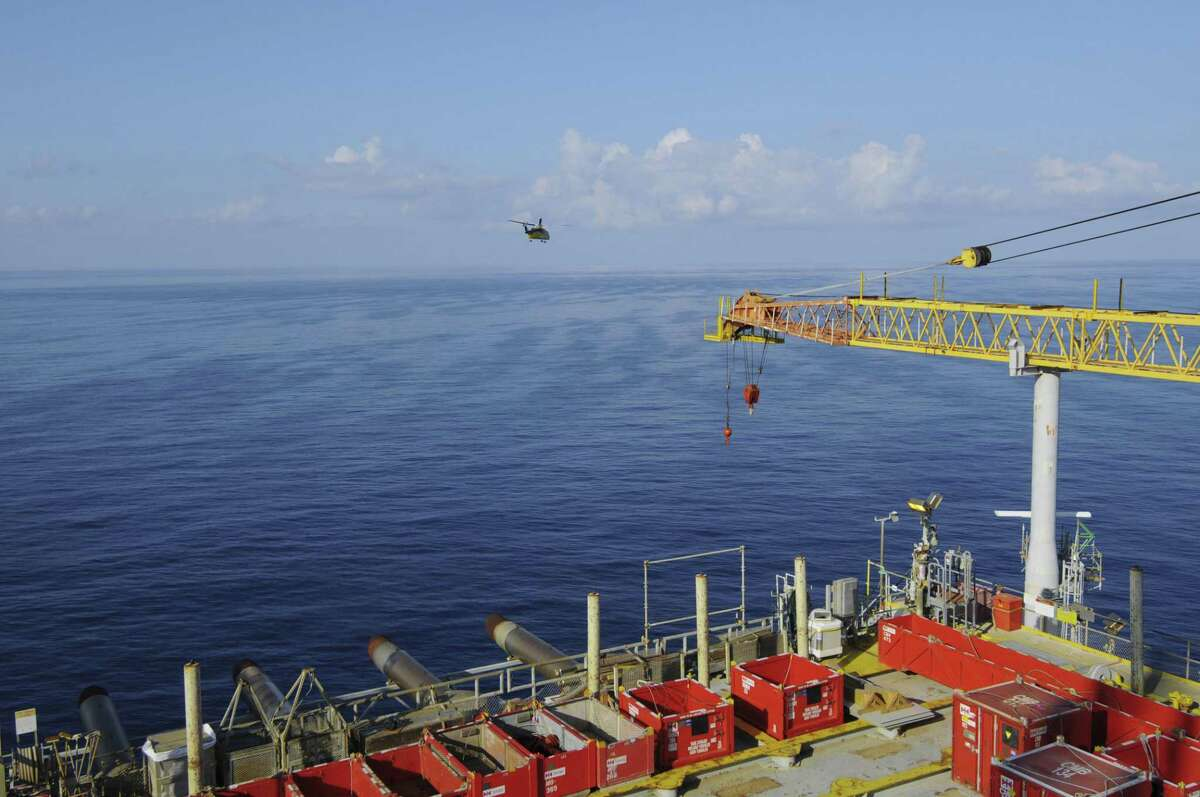 A helicopter leaves Shell Oil's Auger platform in the Gulf of Mexico.