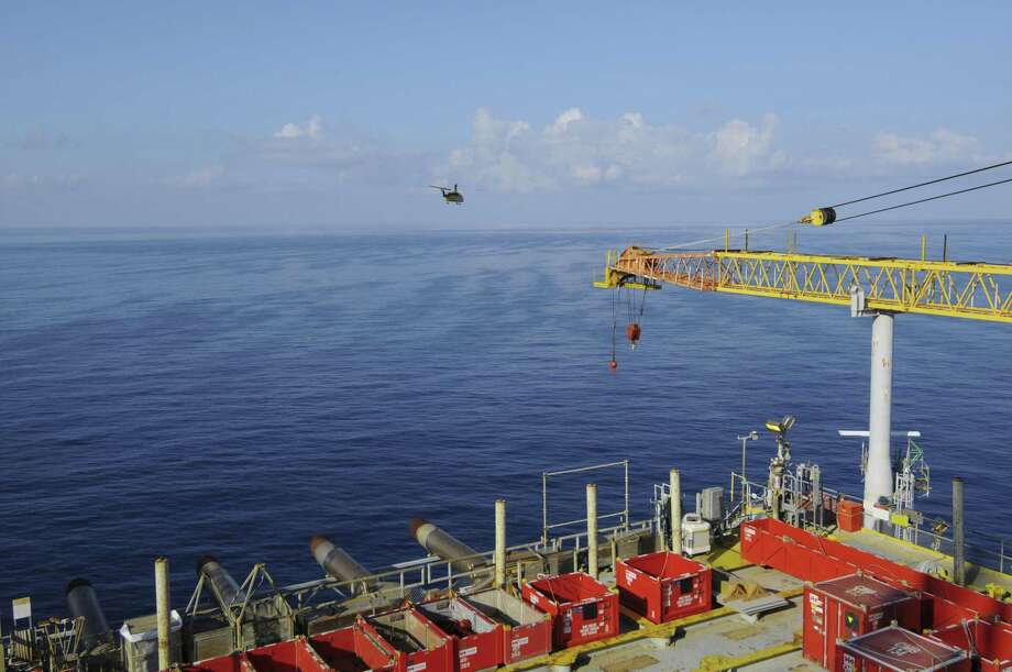 A helicopter leaves Shell Oil's Auger platform in the Gulf of Mexico. Photo: Shell OIl / Mike Duhon Productions all rights assigned in perpetuity excluding external advertising assigned to Shell International limited.