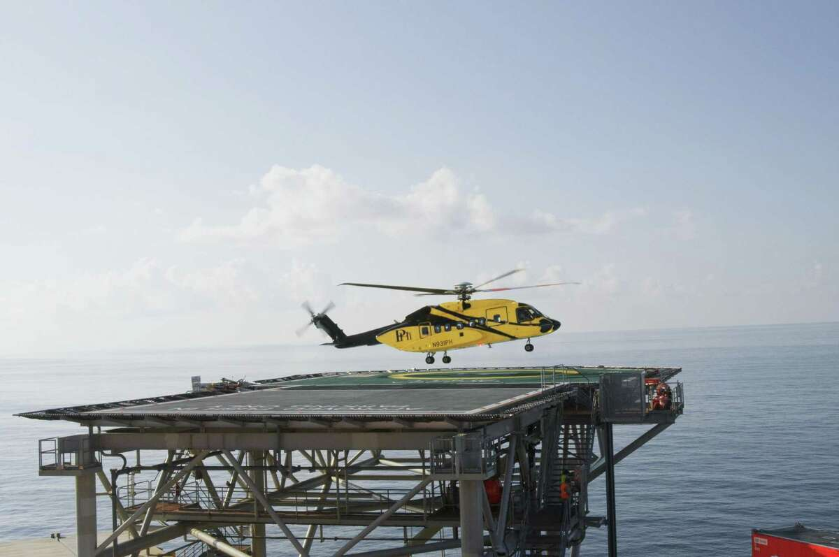 A PHI helicopter leaves Shell Oil's Auger platform in the Gulf of Mexico.