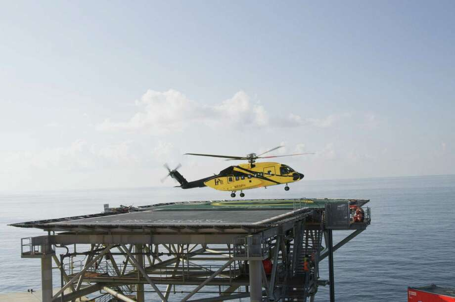 A PHI helicopter leaves Shell Oil's Auger platform in the Gulf of Mexico. Photo: Shell Oil / Mike Duhon Productions all rights assigned in perpetuity excluding external advertising assigned to Shell International limited.