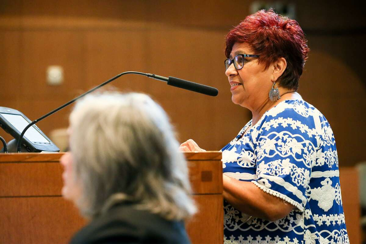 Brenda Pacheco, a lifelong South Side resident, speaks in favor of the city's controversial proposal to downsize the businesses around the mission World Heritage sites during public comment on the issue in the City Council Chamber on Thursday, Aug. 2, 2018.