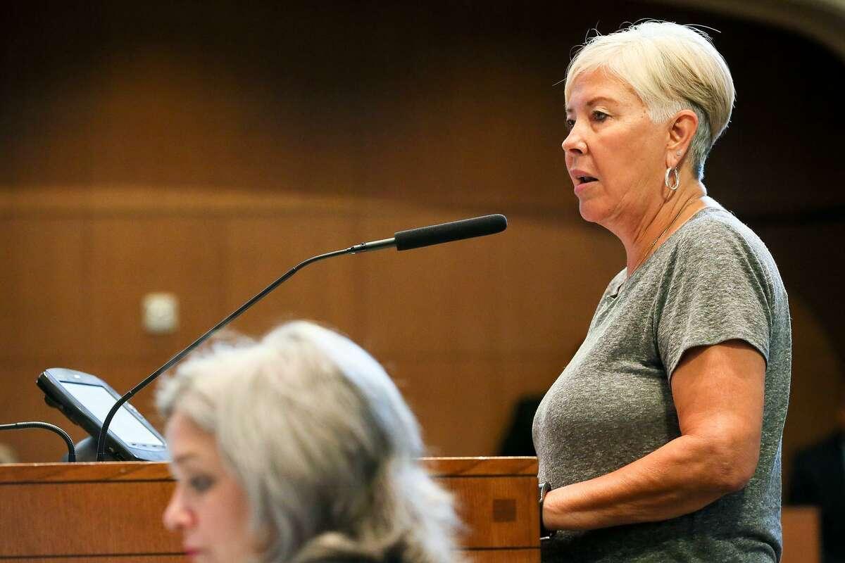 Olga Martinez, president of the Villa Coronado Neighborhood Association, speaks against the city's downzoning proposal.