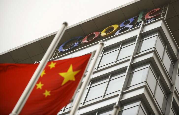 (FILES) This file picture taken on March 22, 2010 shows a Chinese flag flying next to the Google company logo outside the former Google China headquarters in Beijing.  After exiting China eight years ago due to censorship and hacking, Google is tuning a mobile search app that would filter blacklisted search results in order to re-enter the market, according to US media reports. / AFP PHOTO / LIU JINLIU JIN/AFP/Getty Images
