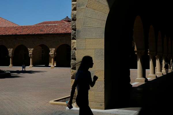 A woman leaves the main quad on the campus of Stanford University June 9, 2016 in Stanford, Calif.