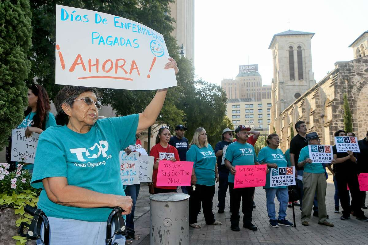 Mary Martinez joins others with Members of Working Texans for Paid Sick Time in a rally in front of City Hall before the City Council meets to ratify signatures to get a proposed paid sick leave ordinance on the November ballot on Thursday, Aug. 2, 2018.