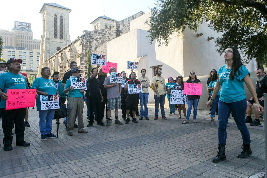 Joleen Garcia (right) leads a Members of Working Texans for Paid Sick Time rally in front of City Hall before the City Council meets to ratify signatures to get a proposed paid sick leave ordinance on the November ballot on Thursday, Aug. 2, 2018. Photo: Marvin Pfeiffer, Staff / San Antonio Express-News / Express-News 2018